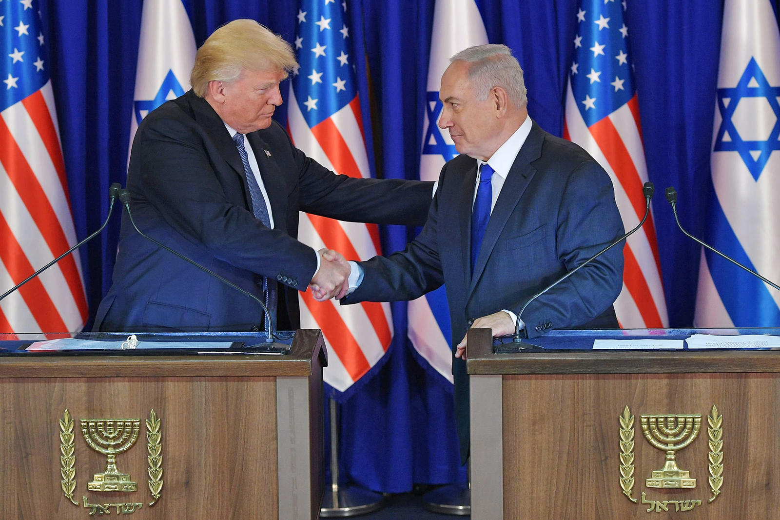 US President Donald Trump (L) and Israel's Prime Minister Benjamin Netanyahu shake hands after delivering press statements before an official diner in Jerusalem on May 22, 2017. / AFP PHOTO / MANDEL NGANMANDEL NGAN/AFP/Getty Images